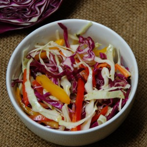 A kicky coleslaw with a oil & vinegar dressing from ascrumptiouslife.com