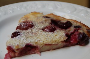 A slice of cherry clafoutis from ascrumptiouslife.com