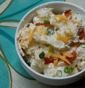Potato Salad with sour cream, mayonaise and your favorite baked potato toppings - from ascrumptiouslife.com