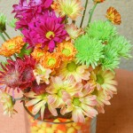 Fall flowers in a candy corn vase from ascrumptiouslife.com.