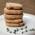 A stack of Parmesan Thyme Crackers from ascrumptiouslife.com