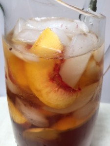 A pitcher of Peach Tea from ascrumptiouslife.com